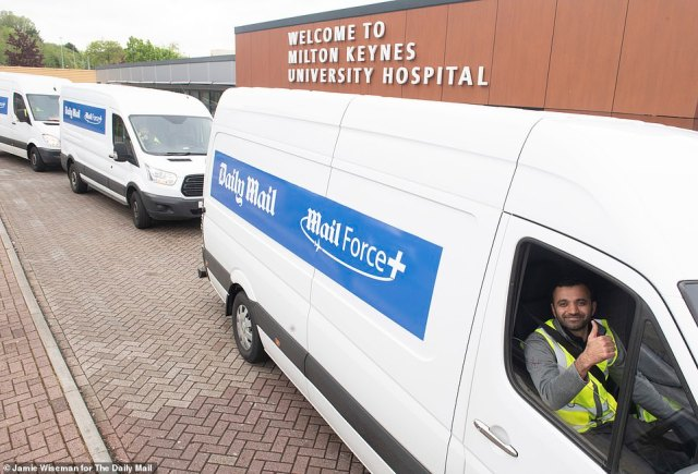 Right on time: The Mail Force van arrives at Milton Keynes University Hospital today with its vital cargo of PPE equiptment