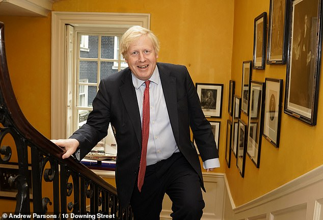 Boris Johnson (pictured, arriving back at Downing Street after the birth of his son) has delayed his paternity leave - but will help change his new son's nappies, friends said last night