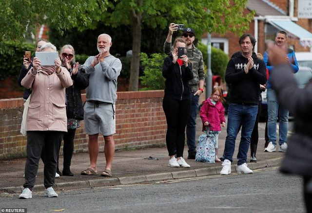 People line the streets inMarston Moretaine to applaud the efforts of Cpt Tom for raising over £30 million for the NHS