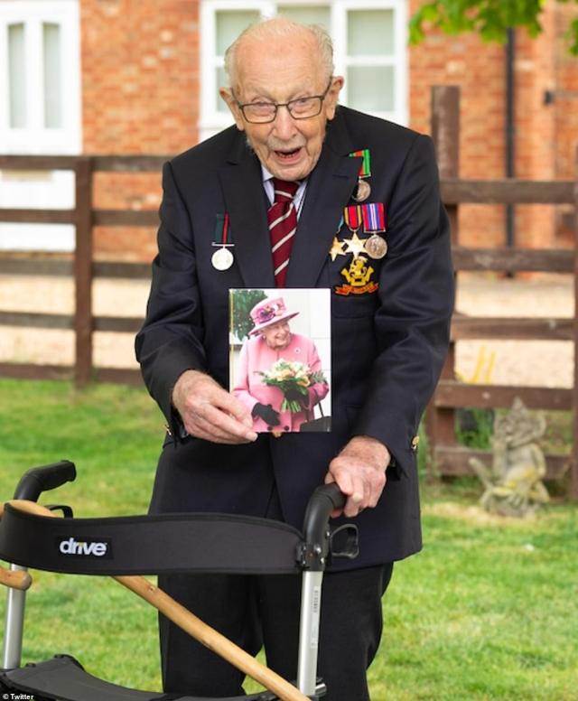 Captain Tom poses with his birthday card which has a personalised message from Her Majesty The Queen