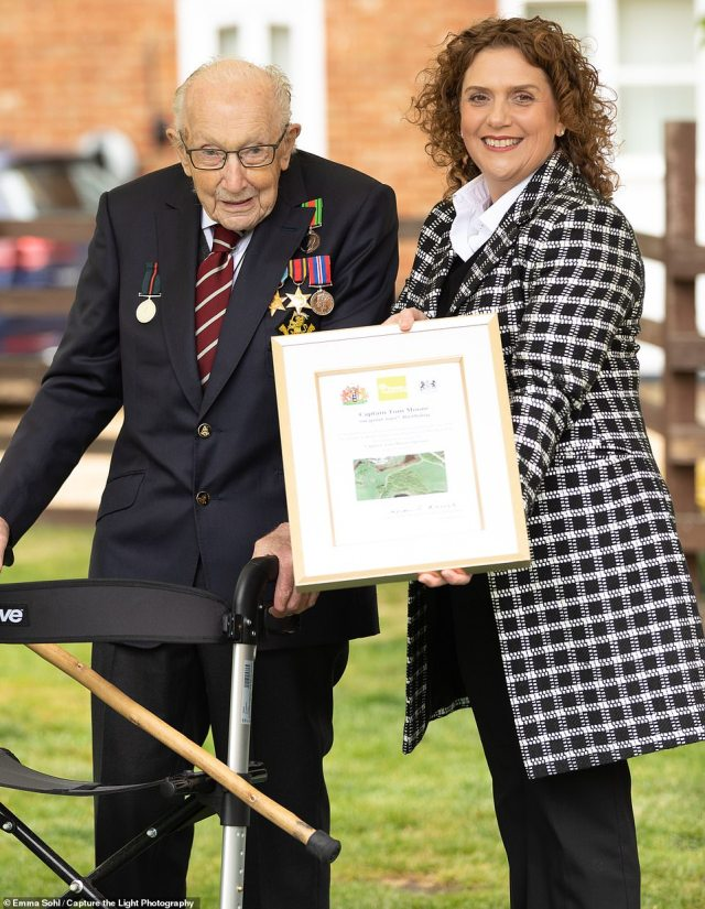 Colonel Tom Moore with his daughter Hannah, and the telegram he received from Her Majesty today
