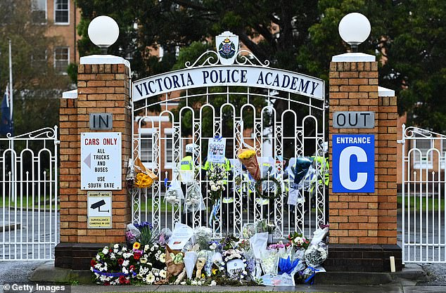 Flowers have again been placed outside of the Victoria Police Academy whereConstable Glen Humphris and Senior Constable Kevin King were farewelled on Friday morning