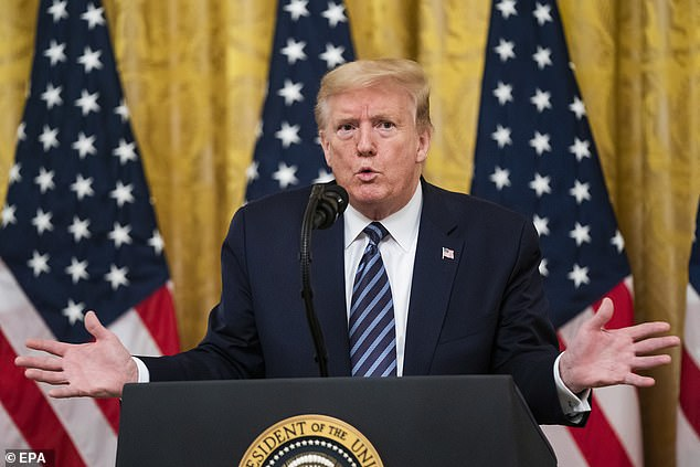 President Trump taking questions from reporters after speaking about the coronavirus pandemic in the East Room of the White House in Washington yesterday