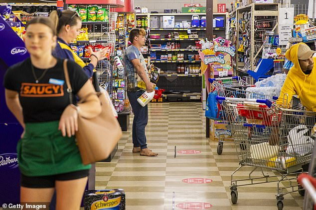 Shoppers are seen observing social distancing at Khan's SUPA IGA in Wakeley, NSW on April 17