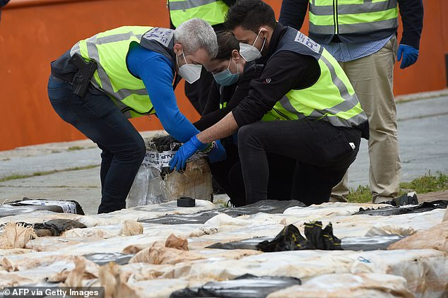 Authorities in Spain inspect cocaine packages after 4,000 tons were loaded from ships in the port of Vigo on April 28