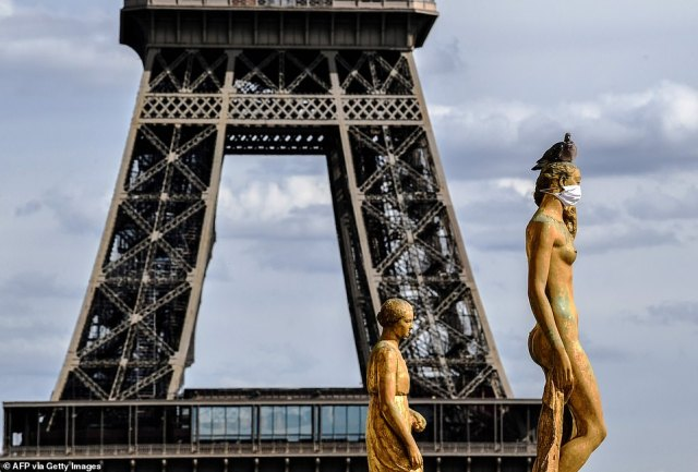 Marine Le Pen in particular has relentlessly criticised the government, saying ministers had lied about 'absolutely everything'. Pictured: The Eiffel Tower and masked bronze statues in front of it