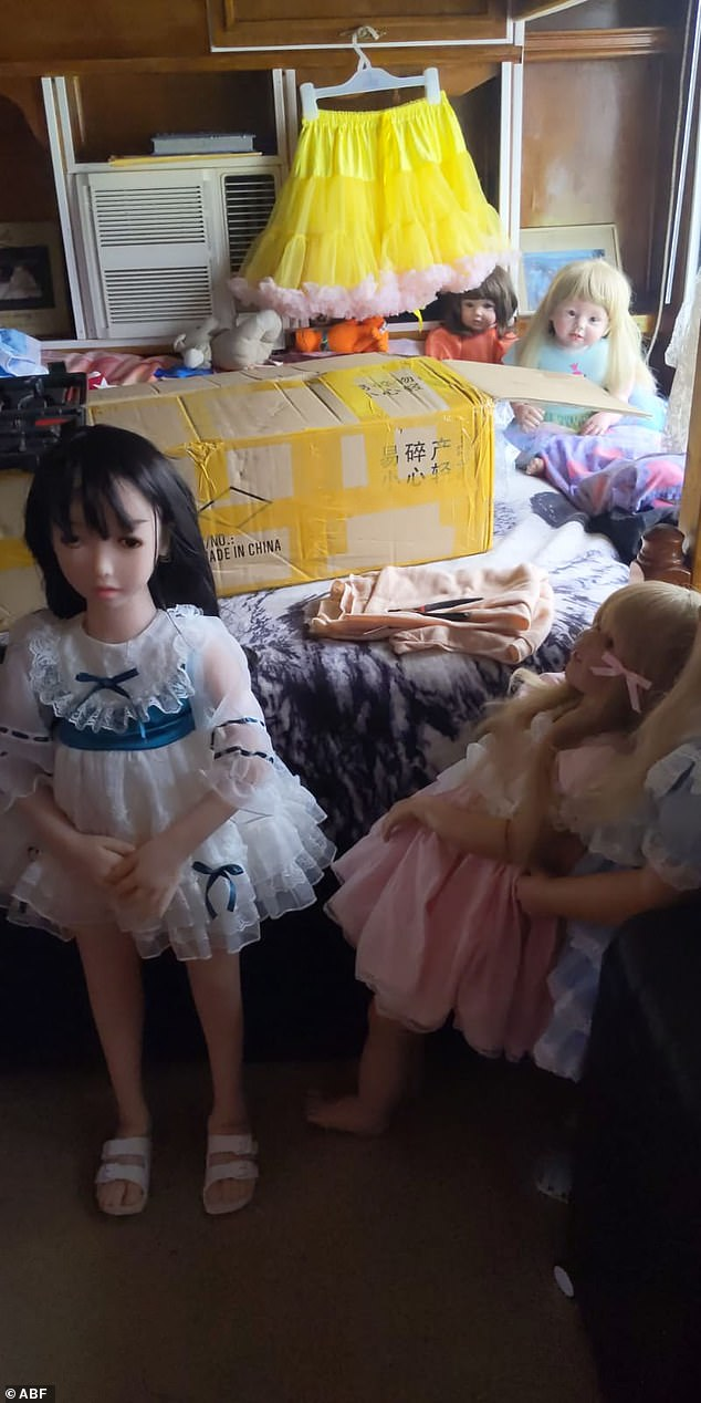 A collection of dolls and clothing seized by police during recent raids