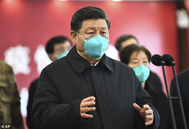 China's President Xi (pictured on March 10 in Wuhan) is facing widespread doubts that his government has covered up the true scale of the outbreak after it emerged in December