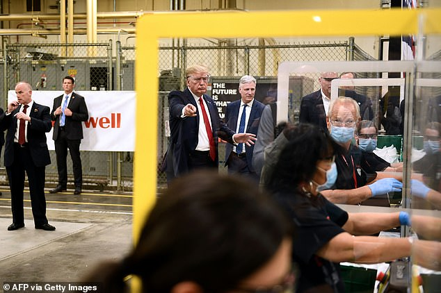 President Trump was surrounded by workers wearing masks during Honeywell's visit on Tuesday. He wore safety glasses, but no mask, during the tour