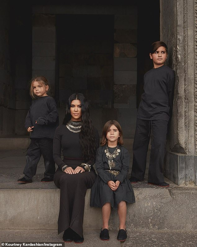 November 28 family portrait: Kourtney is quarantining with her three children - son Mason, 10; daughter Penelope, 7; and son Reign, 5 - while confined to her $8.5M six-bedroom mansion inside the gated community, Estates at the Oaks