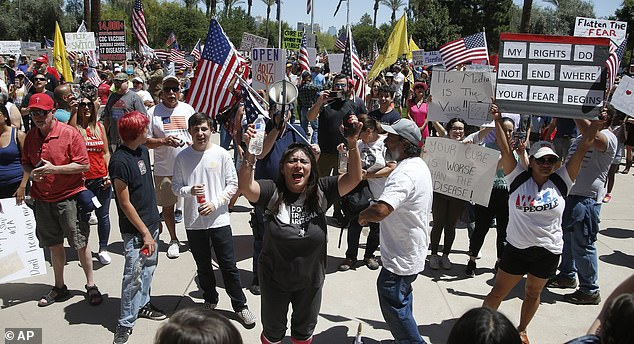 Protesters rally at the Capitol to 're-open' Arizona against the governor's stay-at-home order in late April