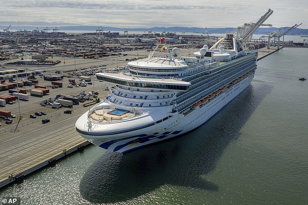 The Grand Princess cruise is pictured moored at the port of Oakland in California. Hundreds of passengers have disembarked from the ship, some of whom have tested positive for the new coronavirus. Three cruise ships that have not carried passengers or crew with the coronavirus will dock at the port of Oakland for several months