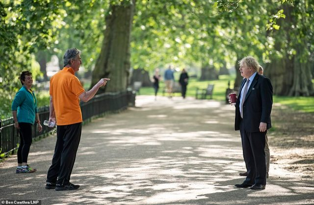 A member of the public stopped to give British Prime Minister Boris Johnson a talking to as he took a morning walk through St James's Park in London yesterday. He was carrying a reusable Costa coffee cup