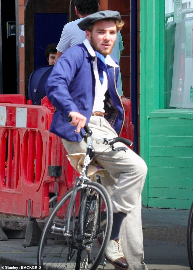 Please sir! Rocco Ritchie, 19, recalled Charles Dickens' Oliver Twist in a vintage ensemble as he rode a bike in central London on Saturday