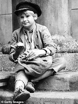 Striking! Mark Lester (photo) as Oliver Twist on the set of the musical film 'Oliver!' in 1968