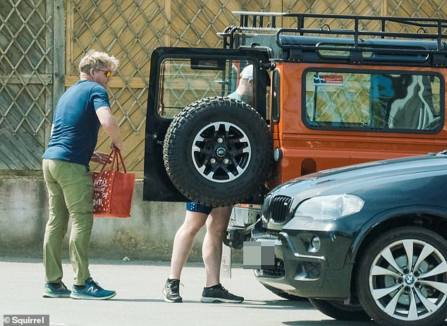 Food for tonight: the Hells Kitchen star loaded his purchases in the back of his Land Rover Defender