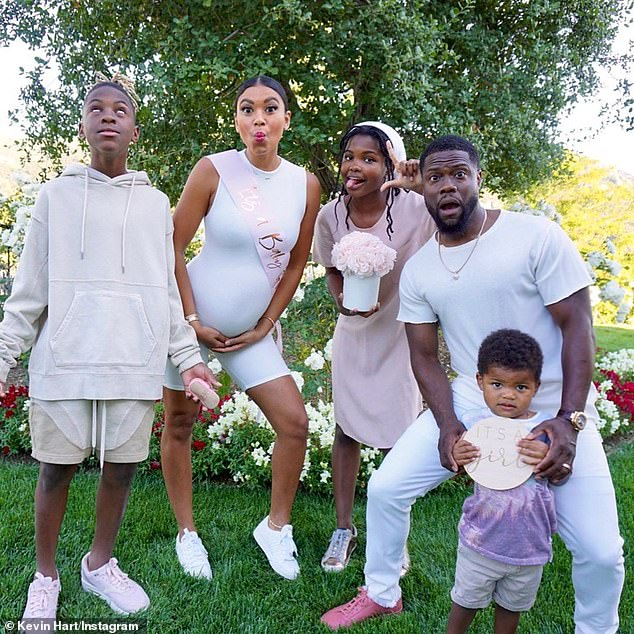 Capturing memories: Kevin posed with Eniko, Kenzo, Heaven and Hendrix for a gender-themed photo shoot in the backyard of his Los Angeles home