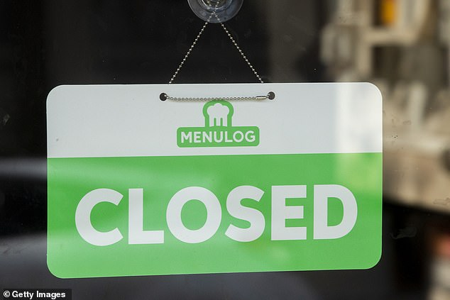 Many businesses throughout the country will be able to reopen as eased coronavirus restrictions are implemented in each state. Pictured: a closed sign in a Newtown restaurant window on Friday