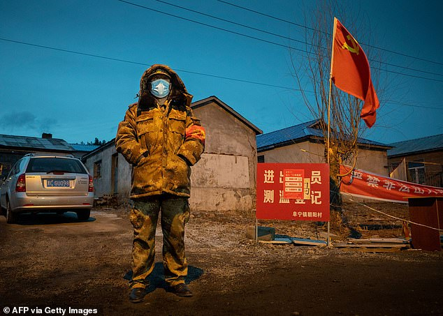 Heilongjiang Province is also on high alert for a return of the virus. Photo shows a man monitoring at a checkpoint in the border town of Suifenhe, Heilongjiang, April 21