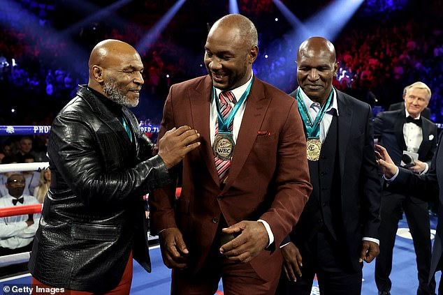 Tyson's former enemy Evander Holyfield (right) says he wants to fight Tyson a third time