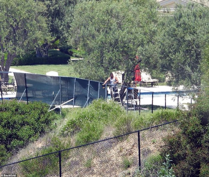Photos taken on Saturday show how easily passers-by can see on the ground. A worker is seen around the pool