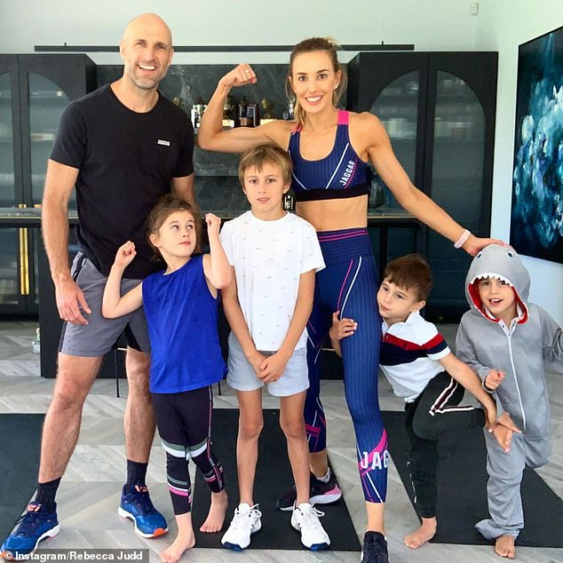 Fit family: The couple share four children, son Oscar, eight, daughter Billie, six, and three-year-old twin boys Tom and Darcy (pictured together)