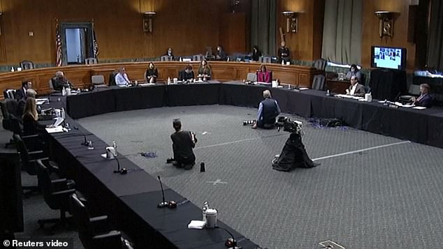 Senators sat at least six feet apart during the hearing, many of whom participated by teleconference