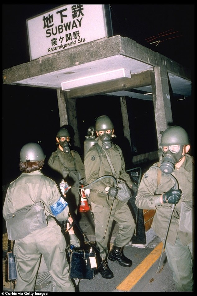 Soldiers are pictured cleaning outKasumigaseki subway station in Tokyo after the Aum Supreme Truth attack in March 1995. The rush-hour poisoning killed 12 commuters