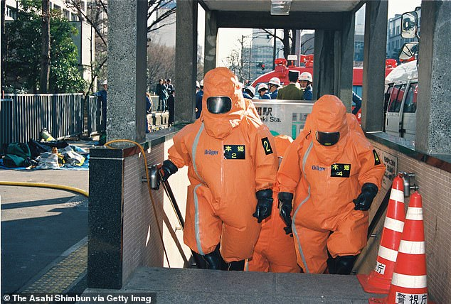Tokyo Fire Department officers are pictured leavingKasumigaseki station on March 20, 1995 in Tokyo after decontaminating the subway