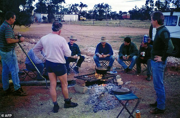 Members of the Australian Federal Police and Western Australian Police are pictured around a campfire at Banjawarn Station as they searched the property in 1995