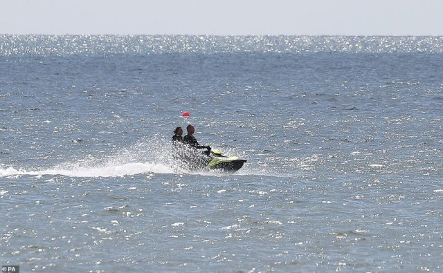 Two people were seen taking to the seas on a jet ski in the off of Bournemouth beach on Wednesday as the sun peeped out