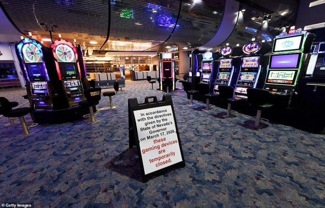 Casinos also remain closed in Las Vegas and the rest of Nevada, which is very dependent on gambling tourism. Pictured: A sign displays a message about the closure of a gaming area with slot machines at McCarran International Airport in Las Vegas, May 14