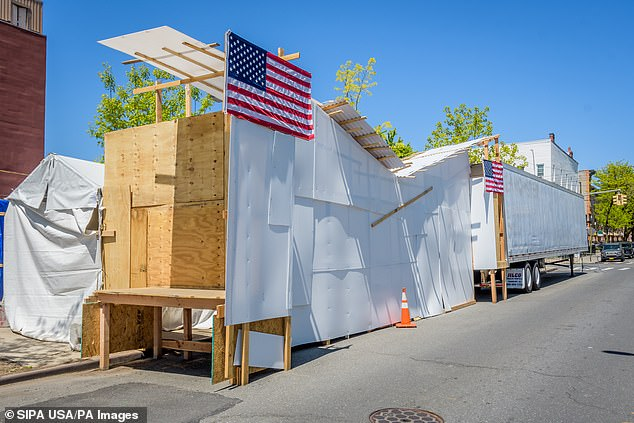 A temporary covered loading dock attached to a refrigerated truck parked outside Wyckoff Hospital in Bushwick, serving as turn-based morgue in an attempt to alleviate funeral homes in Brooklyn neighborhood