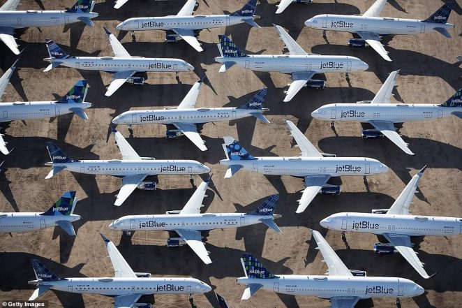 JetBlue planes sit idle on the tarmac waiting for the opportunity to take to the skies again