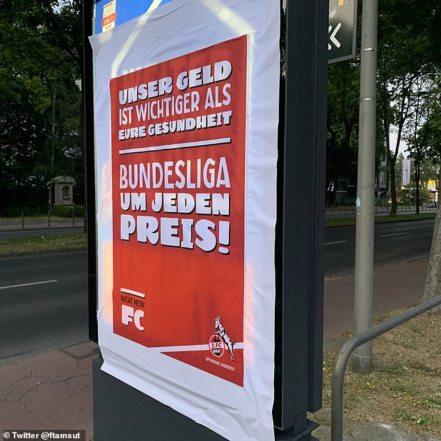 A poster outside the Cologne stadium says 'our money is more important than your health'