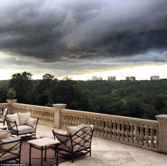A photo Tyler shared in June 2013 of a storm brewing from his `` back deck '' shows the city skyline in the background, surrounded by hills and offering a comfortable outdoor seating area with cushions and a outdoor carpet