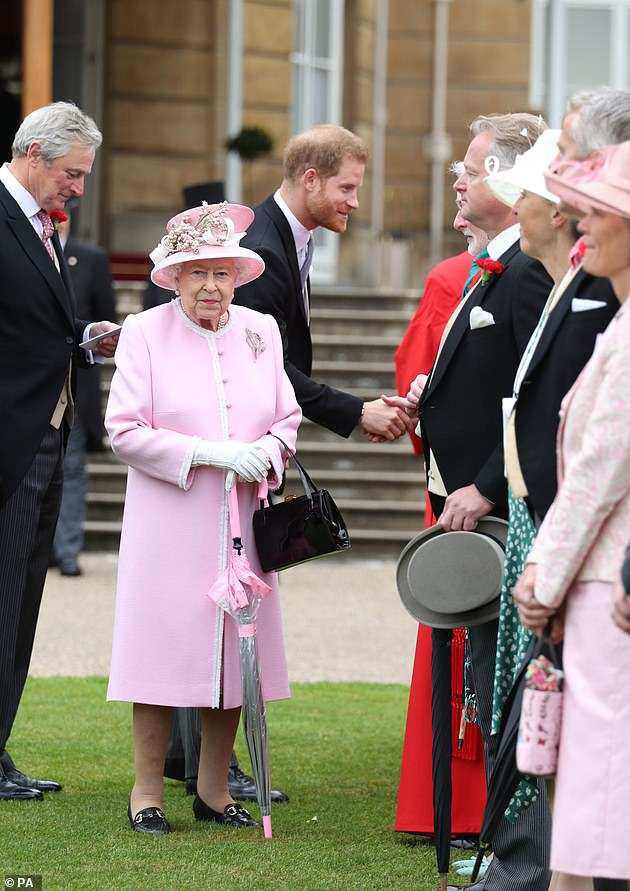 Buckingham Palace celebrated some of the guests who should have attended its summer garden parties and vowed to see them next year instead. Pictured: Queen Elizabeth II and The Duke of Sussex meet guests at a Royal Garden Party at Buckingham Palace in London in 2019