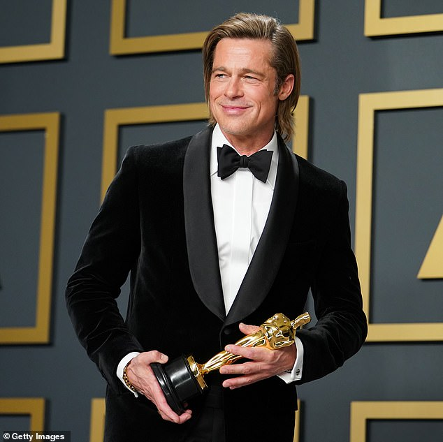 In the air: there is speculation that the Oscars 2021 could be postponed by the Academy of Cinema Arts and Sciences. Brad Pitt is pictured at the 92nd ceremony in February before the pandemic