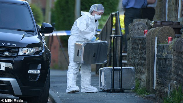 Forensics were at the scene in Wigan on Wednesday afternoon after Belshaw was found with 'catastrophic' injuries, but was unable to be saved by paramedics