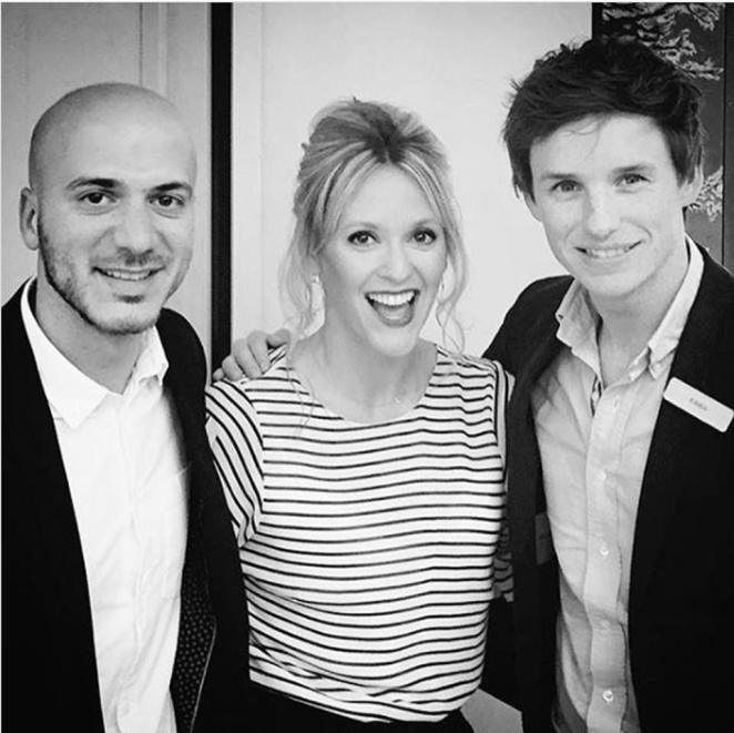 Hassan Akkad, pictured with Eddie Redmayne and Clemency Burton-Hill at a refugee event at the Grove in London, has become a household name after forcing the PM into a U-turn on rights for migrant NHS workers