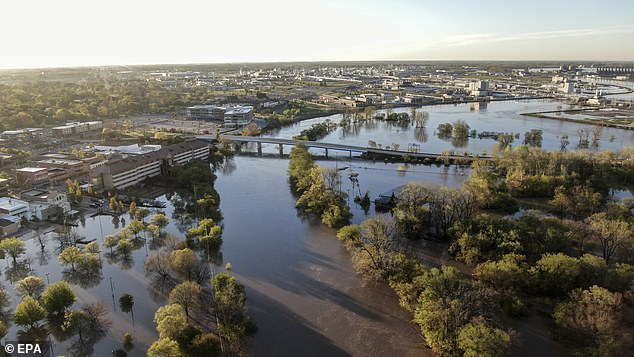An aerial photo shows floodwaters from the Tittabawassee River in the downtown area of Midland, Michigan