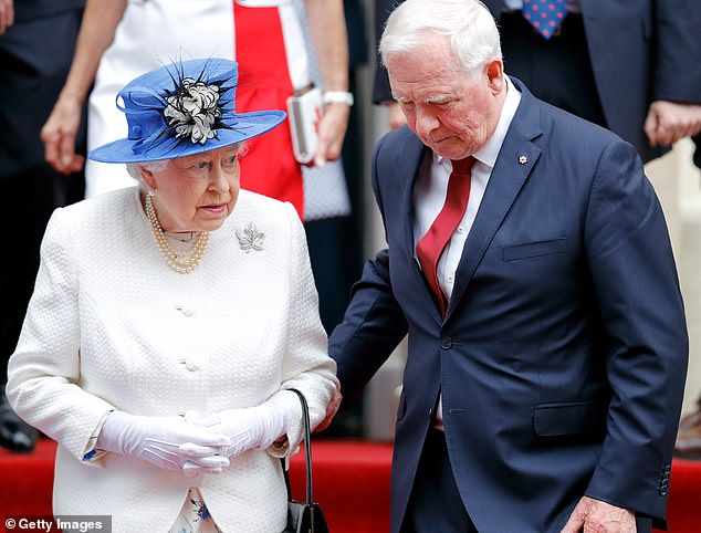 The Queen (pictured with David Johnston, Governor General of Canada), wearing the diamond, platinum-set piece as she departs Canada House in 2017