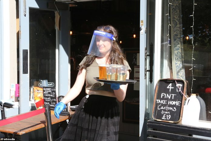 Wetherspoons staff will also receive protective gear this week like this Althorp employee at Wandsworth Common - but will not have to wear it unless the government requests.
