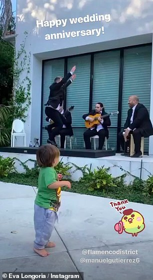 Little dancer: The pair spilled glasses of red wine while listening to music while their one-year-old son Santiago also seemed to enjoy the performance