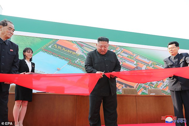 A photo released by the official North Korean Central News Agency shows Kim Jong Un (picturedd centre, May 1) cutting a ribon at a completion ceremony of a factory, marking his supposed first public appearance in 20 days