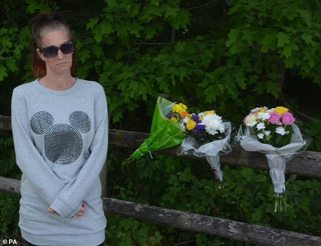 Louise Smith's friend Mandy Fernando (pictured) leaves flowers outside Havant Thicket in Hampshire, where the 16-year-old's body was found on Thursday