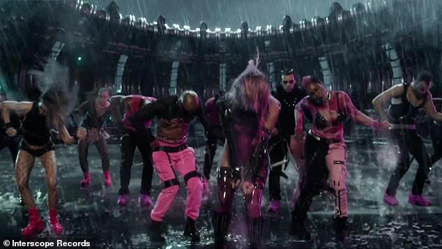 It's raining: the singer seems to be dancing in the post-apocalyptic arena