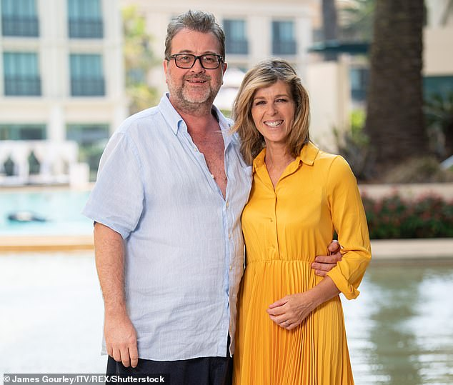 Pictured: Kate Garraway with her husband Derek Draper, who is currently in hospital