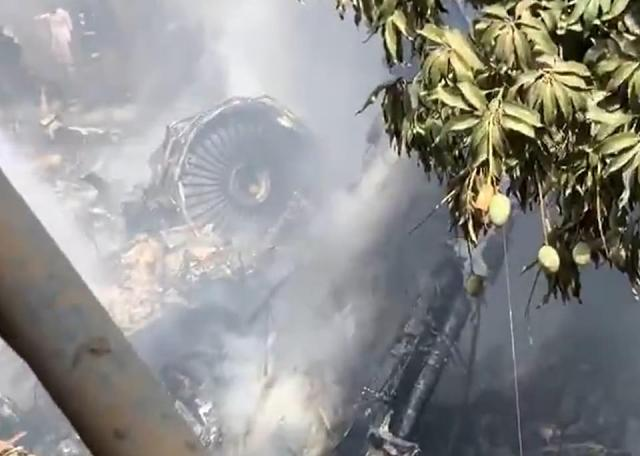 The battered remains of the plane's engine can be seen above mere moments after the crash