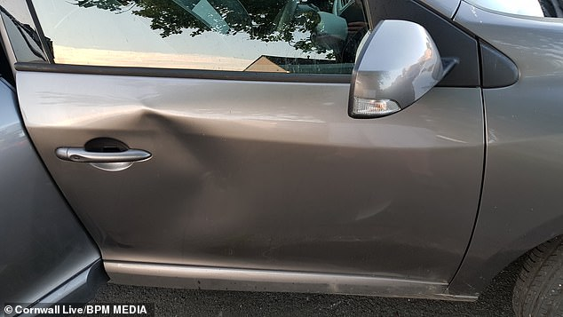 The damage caused by the jogger to Pawel Pasich's vehicle. Mr Pasich, who lives in Plymouth, was enjoying his first trip out of the city on Wednesday since the lockdown restrictions were eased when he captured the jogger on his dash-cam footage